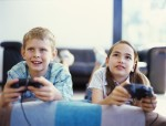 boy and a girl playing video game --- Image by © Royalty-Free/Corbis
