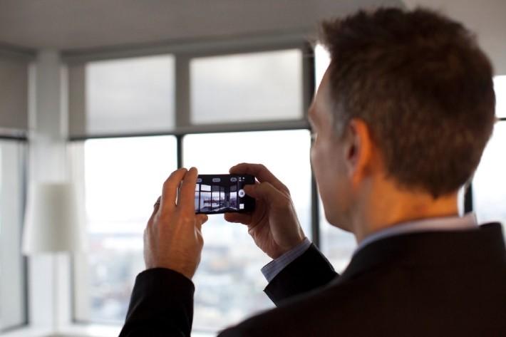 Man-taking-video-inside