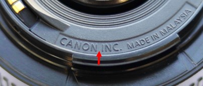 真貨,CANON INC 兩組字之間會有空格。