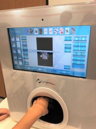 放入手指,從打印機屏幕可看到手指的位置,確定後即可打印。