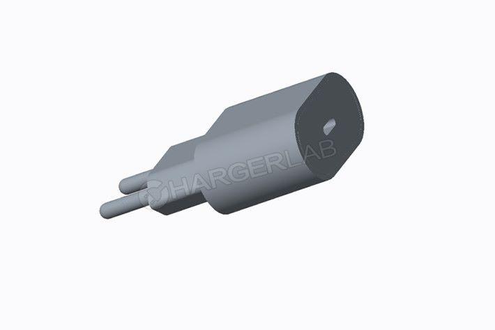 5 月時流出的新 iPhone 火牛設計圖,較這次曝光的工程樣本火牛扁圓,像個旅行電源插頭轉接器。