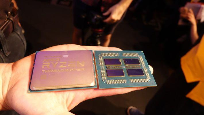 Threadripper 32 核心 CPU 的實物,可見它有 4 個晶片。(筆者攝於 Computex 2018)