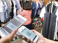 掃描QR code付款普及 零售商一機迎接商機