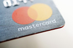 A Mastercard credit card is displayed for a photograph in Tiskilwa, Illinois, U.S., on Tuesday, Sept. 18, 2018. Visa Inc. and Mastercard Inc. agreed to pay as much as $6.2 billion to end a long-running price-fixing case brought by merchants over card fees, the largest-ever class action settlement of an antitrust case. Photographer: Daniel Acker/Bloomberg