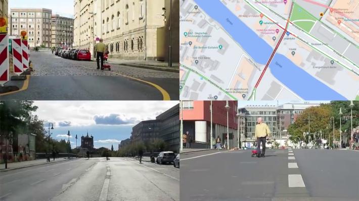 男子拖著小拖車和 99 部開著 Google Map 的手機,在沒有車的橋上行走, Google Map 上即顯示橋上交通擠塞(圖右上)。